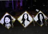 Pinturas de las caras de las tres jóvenes muertas en operativo militar durante la dictadura